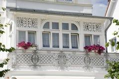 Typical white balcony on rügen, germany Stock Photo