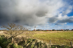 Typical white church in landscape at the island, Texel, Holland Royalty Free Stock Photos