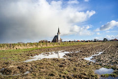 Typical white church in landscape at the island, Texel, Holland Royalty Free Stock Photo