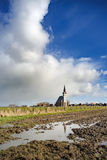 Typical white church in landscape at the island, Texel, Holland Stock Photography