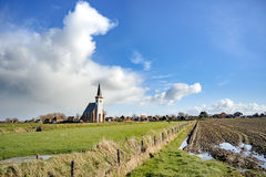 Typical white church in landscape at the island, Texel, Holland Royalty Free Stock Images