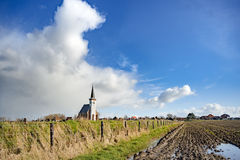 Typical white church in landscape at the island, Texel, Holland Royalty Free Stock Photography