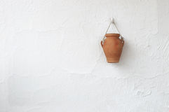 Typical white country house wall in a Mediterranean village with a clay handmade vase Stock Images