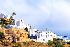 Typical white houses with blue shutters of Greek Island Ios Royalty Free Stock Photos
