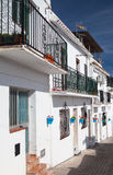 Typical white houses in Mijas. Typical white houses in  the narrow street of Mijas - Andalusia, Spain Stock Photo