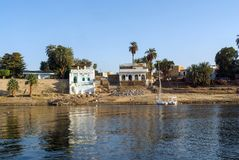 Typical white houses of a Nubian village surrounded by palm trees near Cairo Egypt and on the banks. Of the Nile River Stock Photography