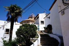 Typical white houses, steps and church in Altea