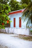 Typical white simple rural house architecture of Maldives village. Fulhadhoo island Royalty Free Stock Photos