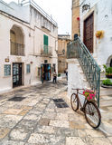 Typical white street with bicycle  in Ostuni, Italy Royalty Free Stock Image