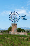 Typical windmill in Majorca. Typical windmill in Mallorca wind on a sunny day Royalty Free Stock Photography