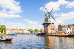 Typical windmill and medieval architecture in Haarlem, Netherlands Royalty Free Stock Photo