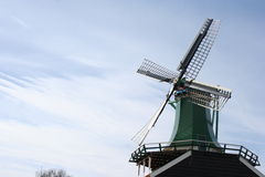 Windmill in Holland. A typical windmill in the Zaanse Schans village, very close to Amsterdam, Holland Royalty Free Stock Photo