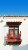 Typical window balcony of a house in the historic center of the port city of Cartagena de Indias. Stock Photography