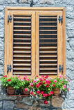 Typical window of a  stone house with wooden shutters closed and Stock Photography