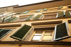 Typical windows with venetian blinds in Firenze, Italy Stock Photos