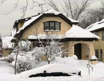 Typical Wisconsin house after heavy snow fall Royalty Free Stock Photos