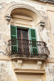 Typical wooden balcony with shutter on old building in Mdina, Ma Royalty Free Stock Image