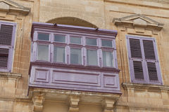 Typical wooden balcony with shutter on old building in Mdina, Ma Royalty Free Stock Photography