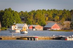 Wooden boathouses at sunset in Aland archipelago, where nature is magnified stock photos