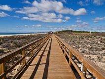 Typical wooden foot path along the beach between Vilamoura and Albufeira. Typical wooden foot path leading from Vilamoura to Albufeira along the beach in royalty free stock images
