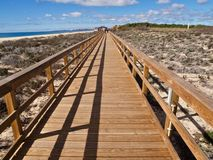 Typical wooden foot path along the beach between Vilamoura and Albufeira. Typical wooden foot path leading from Vilamoura to Albufeira along the beach in stock photos