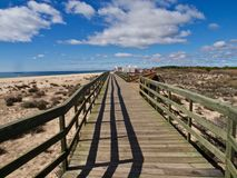 Typical wooden foot path along the beach between Vilamoura and Albufeira. Typical wooden foot path leading from Vilamoura to Albufeira along the beach in royalty free stock image