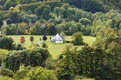 Typical wooden small farm house in victorian style in Bennington. Vermont, USA in the green mountain area Stock Photography