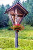 Typical wooden wayside cross in mountain Royalty Free Stock Photography