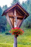 Typical wooden wayside cross in mountain Stock Photo