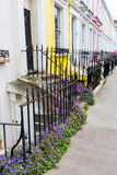Typical wrought iron fence in Notting Hill, London. Typical wrought iron fence in front of row houses Notting Hill, London, UK Royalty Free Stock Images