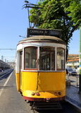 Typical yellow tram in Lisbon, Portugal. Typical old-fashioned tram stopping at the Cais do Sodré railway station downtown Lisbon, Portugal Royalty Free Stock Images