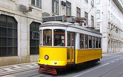 Typical yellow tram on the street of Lisbon. Portugal royalty free stock photo