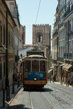 Typical Yellow Vintage Tram in Narrow Street of Lisbon, Portugal.  stock photography