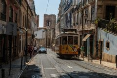 Typical Yellow Vintage Tram in Narrow Street of Lisbon, Portugal.  royalty free stock image