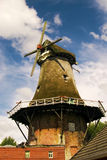 Typically East Frisian windmill in Upgant-Schott. Historical windmill at the street edge in the East Frisian Small Town in Upgant-Schott Royalty Free Stock Photo