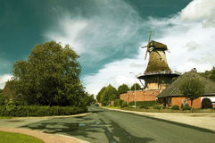 Typically East Frisian windmill in Upgant-Schott. Historical windmill at the street edge in the East Frisian Small Town in Upgant-Schott Stock Photos