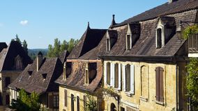 Picturesque homes in St Cyprien, Dordogne, France. Typically French architecture lines the street in St Cyprien, Dordogne, France stock photography