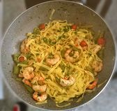 Tagliatelle with prawns, asparagus and cherry tomatoes royalty free stock image