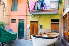 Typically Mediterranean brightly colored terrace styled homes wi. CINQUE TERRE, ITALY - APRIL 25 2018; Typically Mediterranean brightly colored terrace styled royalty free stock photo