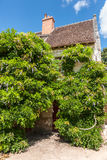 Typically picturesque 16th century French farmhouse in romantic Royalty Free Stock Photos