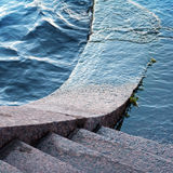 Typically stone steps down to the river Stock Photography