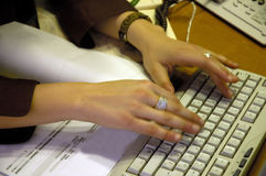 Typing. At a computer keyboard Royalty Free Stock Photography