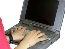Typing. Boy hand typing on laptop Stock Image