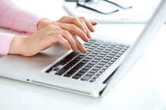 Typing. Closeup of woman's hand typing on laptop Royalty Free Stock Image