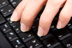 Typing. Female fingers on the keyboard Stock Photo