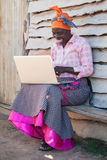 Typing. An african lady is learning the ways of a computer Stock Photography