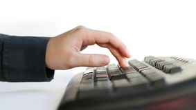 Typing. Male hand typing on a keyboard royalty free stock photography
