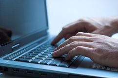 Typing. On a laptop keyboard, shallow depth of field stock images
