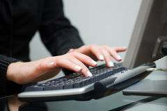 Woman typing on computer keyboard Royalty Free Stock Photo