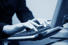 Woman typing on computer keyboard Stock Image